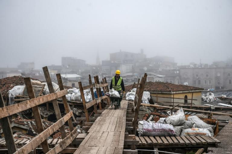 A worker pushes a wheelbarrow on the top of Istanbul's historic market, the Grand Bazaar