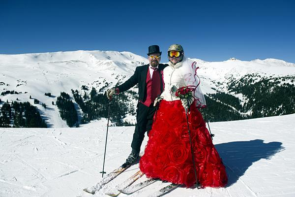 Tucker and Karyn Brown pose for a portrait while celebrating their 10th wedding anniversary during the Loveland Ski Area 26th Annual Valentine's Day Mountaintop Matrimony held near Georgetown, Colorado on February 14, 2017. Over 70 couples gathered to either wed or renew their vows during the ceremony which was officiated by Minister Harry Heilmann, of the Universal Life Church.