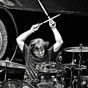 Simon Wright is an English drummer formally of legendary rock bands AC/DC, DIO, UFO, Rhino Bucket, and Geoff Tate's Queensrÿche.