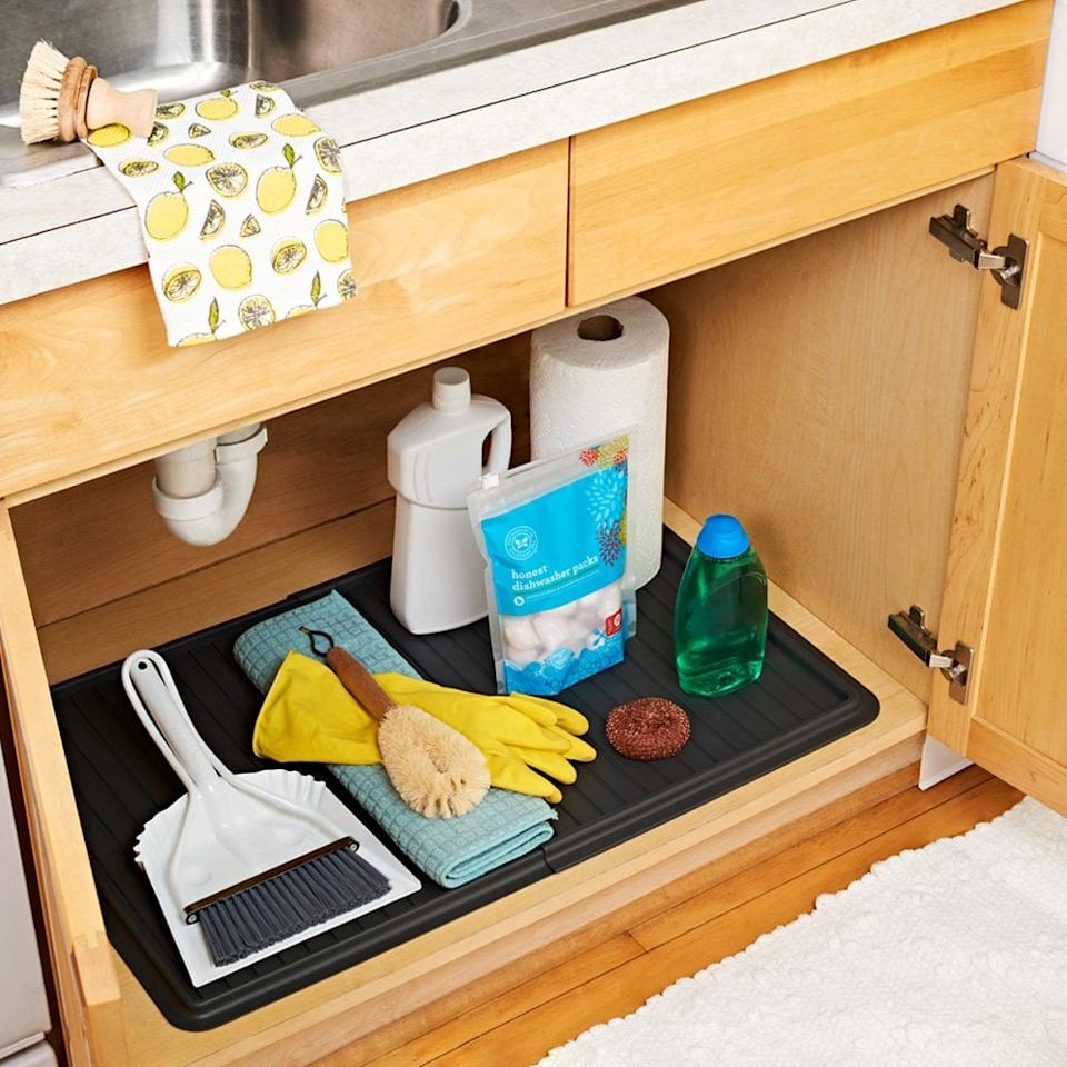 "<p>This <a href=""https://www.popsugar.com/buy/Madesmart-Expandable-Under-Sink-Drip-Tray-488306?p_name=Madesmart%20Expandable%20Under%20Sink%20Drip%20Tray&retailer=amazon.com&pid=488306&price=20&evar1=casa%3Aus&evar9=46583359&evar98=https%3A%2F%2Fwww.popsugar.com%2Fphoto-gallery%2F46583359%2Fimage%2F46585398%2FMadesmart-Expandable-Under-Sink-Drip-Tray&list1=shopping%2Corganization%2Chome%20organization%2Chome%20shopping&prop13=api&pdata=1"" rel=""nofollow"" data-shoppable-link=""1"" target=""_blank"" class=""ga-track"" data-ga-category=""Related"" data-ga-label=""https://www.amazon.com/madesmart-Expandable-Undersink-Drip-Tray/dp/B0792FGDXF?ref_=ast_sto_dp"" data-ga-action=""In-Line Links"">Madesmart Expandable Under Sink Drip Tray</a> ($20) is a great way to keep your products in place and organized.</p>"