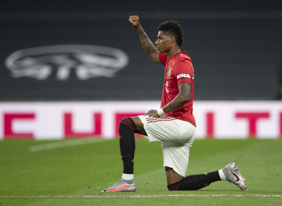 Manchester United's Marcus Rashford of Manchester United takes a knee in support of the 'Black Lives Matter' - an image seen at every Premier League match since the league's restart