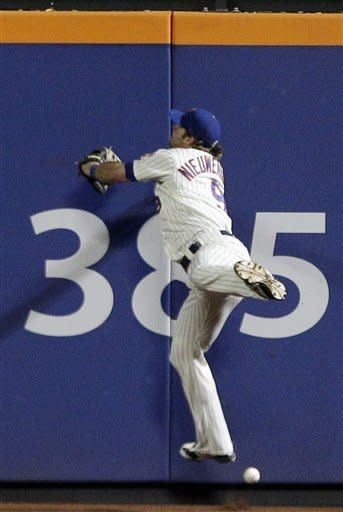 New York Mets center fielder Kirk Nieuwenhuis loses control of a ball hit by Cincinnati Reds' Wilson Valdez during the seventh inning of a baseball game, allowing two runs to score on Friday, June 15, 2012, in New York. (AP Photo/Frank Franklin II)