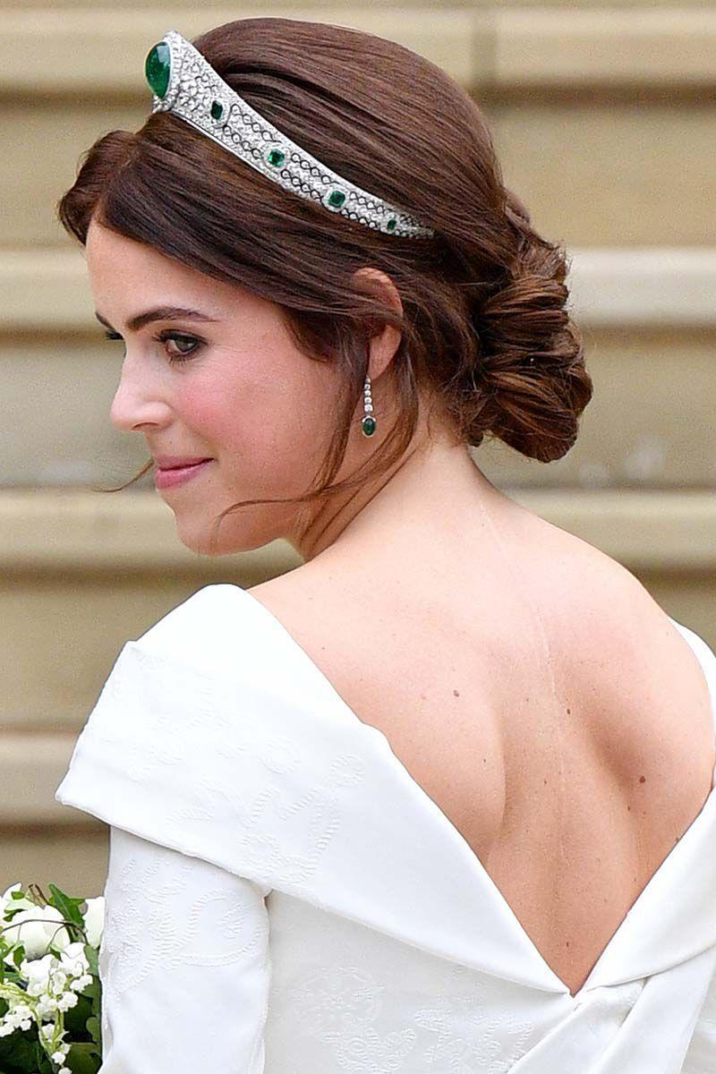 <p>For her wedding day, Princess Eugenie tapped hairstylist Sonnie Jo Macfarlane, who pulled her silky locks back into a twisted chignon with face framing tendrils.</p>