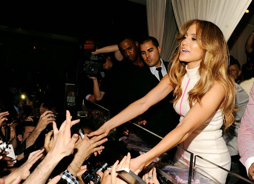 "Jennifer Lopez is ""on the fence about divorcing Marc Anthony,"" reveals <em>Star</em>. The mag notes Anthony's working ""hard to get his family back together,"" and J.Lo is ""afraid of change and isn't good at being alone."" For how Anthony's trying to win back Lopez, and whether she'll call off the divorce, check out what a J. Lo insider confides to <a href=""http://www.gossipcop.com/jennifer-lopez-calling-off-divorce-marc-anthony-reconciling-back-together/"">Gossip Cop</a>."