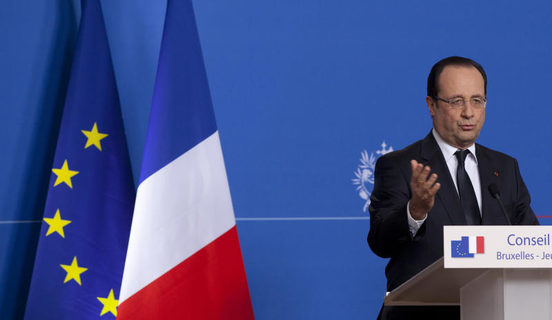 French President Francois Hollande speaks during a media conference at an EU summit in Brussels on Thursday, March 14, 2013. European Union heads of state and government meet for a two-day summit, beginning Thursday, to discuss the current financial crisis. (AP Photo/Virginia Mayo)