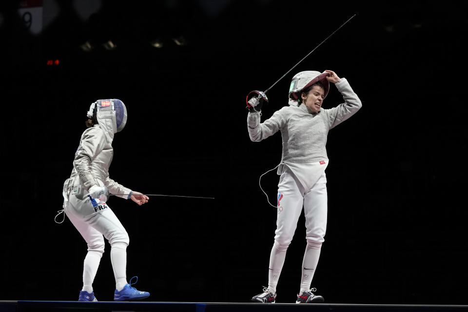 Olga Nikita of the Russian Olympic Committee, right, celebrates defeating Cecilia Berder of France and won with her teammates the women's Sabre team final competition at the 2020 Summer Olympics, Saturday, July 31, 2021, in Chiba, Japan. (AP Photo/Hassan Ammar)