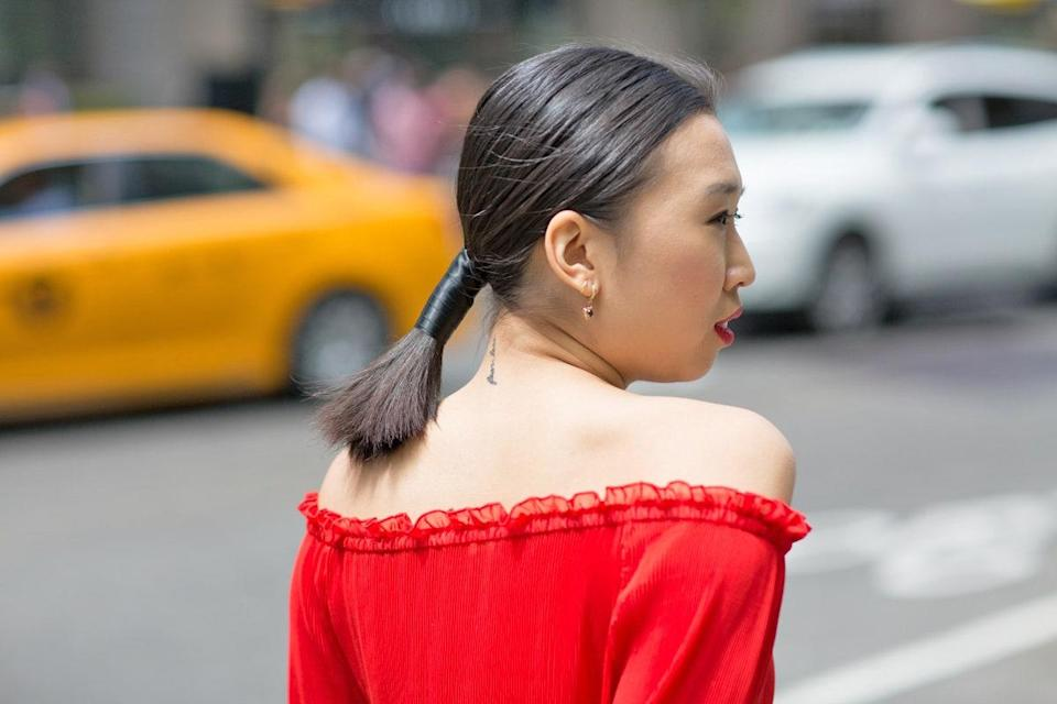 Looking for an easy way to spice up a basic pony? Wrap a thin ribbon a few inches around a low ponytail. Stick to a shade that matches your natural hair color to keep it looking sleek, or go with a contrasting color for something edgier.