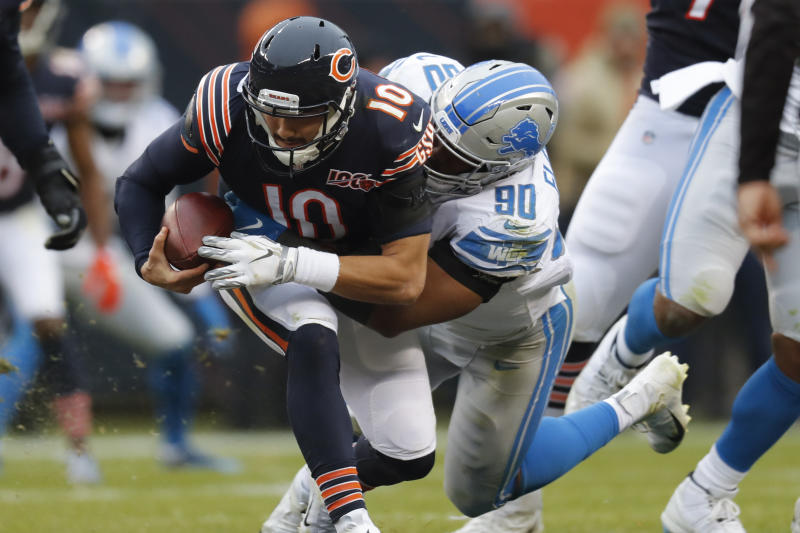Detroit Lions defensive end Trey Flowers (90) sacks Chicago Bears quarterback Mitchell Trubisky (10) during the second half of an NFL football game in Chicago, Sunday, Nov. 10, 2019. (AP Photo/Charles Rex Arbogast)