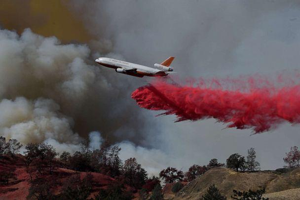 PHOTO: A fire fighting aircraft intervene in a fire broke out at Geyserville town in Sonoma County, California, United States on October 25, 2019. (Neal Waters/Anadolu Agency via Getty Images)