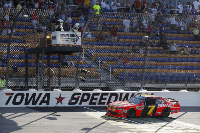 Justin Allgaier crosses the finish line while winning the NASCAR Xfinity Series auto race, Sunday, June 17, 2018, at Iowa Speedway in Newton, Iowa. (AP Photo/Charlie Neibergall)