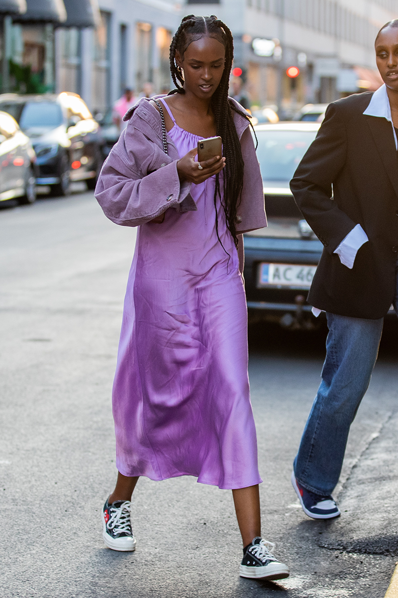 """<p>One of our favourite street style tricks is pairing fancier items with more affordable finds. And what better way to do this than by sliding on a pair of <a href=""""https://www.cosmopolitan.com/uk/fashion/style/a27431191/womens-white-trainers/"""" rel=""""nofollow noopener"""" target=""""_blank"""" data-ylk=""""slk:white trainers"""" class=""""link rapid-noclick-resp"""">white trainers</a> with a bright tailored trouser suit or sexy slip dress?</p>"""