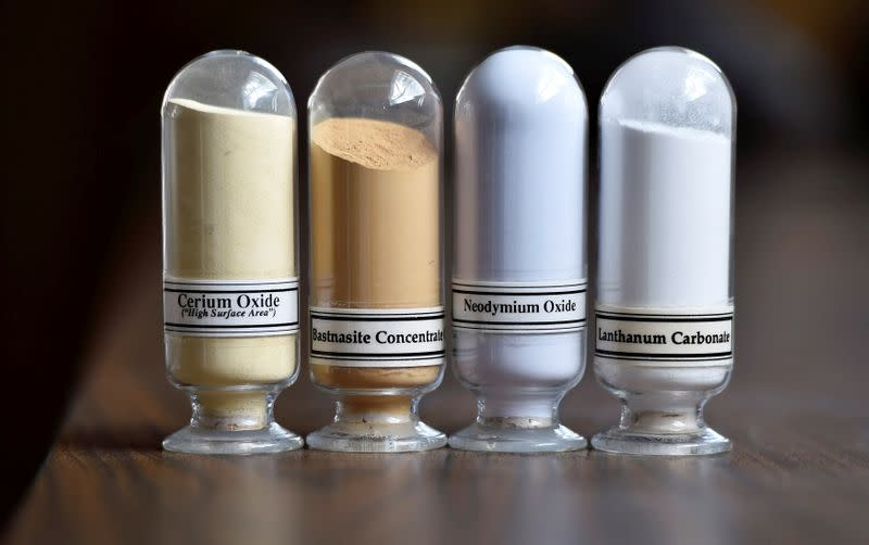 FILE PHOTO: Samples of rare earth minerals, Cerium oxide, Bastnasite, Neodymium oxide and Lanthanum carbonate are on display during a tour of Molycorp's Mountain Pass Rare Earth facility in Mountain Pass, California