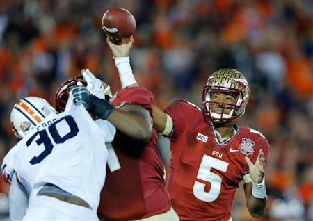 Florida State Seminoles quarterback Jameis Winston throws a pass against the Auburn Tigers in the fourth quarter during the NCAA BCS Championship football game in Pasadena