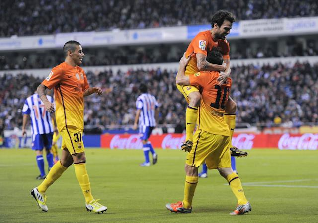 LA CORUNA, SPAIN - OCTOBER 20: Lionel Messi of FC Barcelona (R) celebrates with his teammate Cesc Fabregas of FC Barcelona after scoring his team's fourth goal during the La Liga match between Deportivo La Coruna and FC Barcelona at Riazor Stadium on October 20, 2012 in La Coruna, Spain. (Photo by David Ramos/Getty Images)