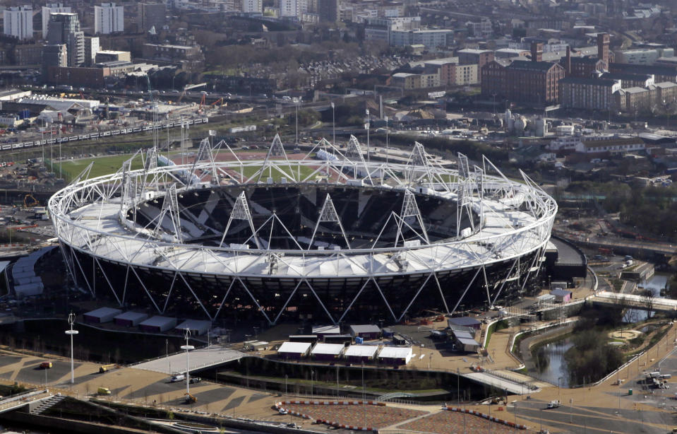 The gated Bow Quarter apartment complex is seen at right near the Olympic stadium in London in a March 27, 2012 file photo. REUTERS/Stefan Wermuth