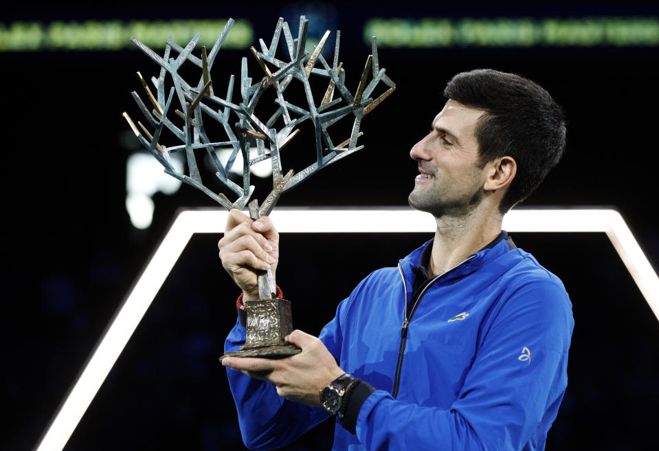 Novak Djokovic of Serbia lifts the trophy after winning the final match of the Paris Masters tennis tournament in Paris, Sunday, Nov. 3, 2019. Djokovic defeated Denis Shapovalov of Canada 6-3/6-4. (AP Photo/Kamil Zihnioglu)