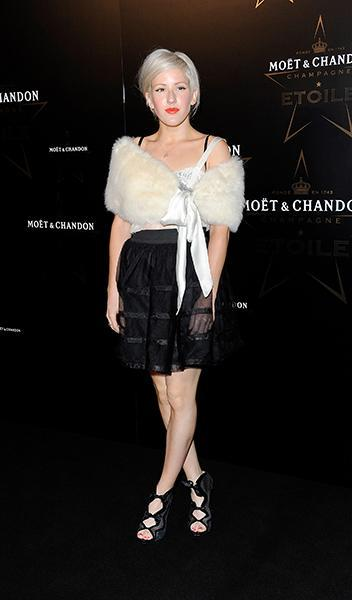 """<div class=""""caption-credit""""> Photo by: Getty Images</div><div class=""""caption-title"""">Arriving at the Moet & Chandon Etoile Award Gala honoring Mario Testino in 2011</div>Glamazon alert! Channelling the style of Old Hollywood, Ellie arrived sporting a bright lip and a cozy fur stole--achieving a look that is both weather-appropriate and stylish."""