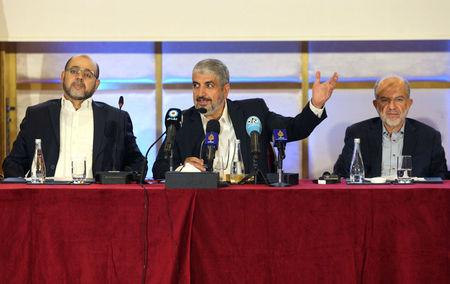 Hamas leader Khaled Meshaal gestures as he announces a new policy document in Doha