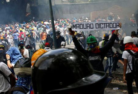 A demonstrator holds a sign in Caracas