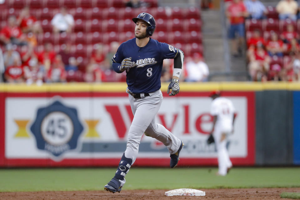 FILE - In this Sept. 24, 2019, file photo, Milwaukee Brewers' Ryan Braun runs the bases after hitting a solo home run during the second inning of the team's baseball game against the Cincinnati Reds in Cincinnati. The Brewers have declined to exercise a $15 million mutual 2021 option on Braun as the franchise's career home run leader ponders whether to continue playing. Braun is due a $4 million buyout. The 37-year-old often said this year that this might be his final season. He has spent his entire career in Milwaukee and has a franchise-record 352 career home runs. (AP Photo/John Minchillo, File)