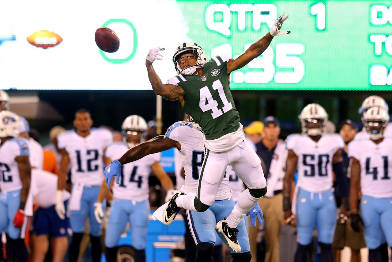 Aug 12, 2017; East Rutherford, NJ, USA; New York Jets corner back Buster Skrine (41) breaks up a pass intended for Tennessee Titans tight end Delanie Walker (82) during the first quarter of a preseason game at MetLife Stadium. Mandatory Credit: Brad Penner-USA TODAY Sports     TPX IMAGES OF THE DAY