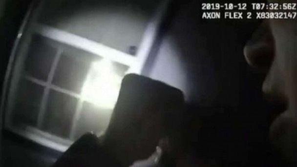PHOTO: A police officer is seen in bodycam footage shining a flashlight moments before shooting into a window, striking a woman and killing her. (WFAA via Fort Worth Police Department)