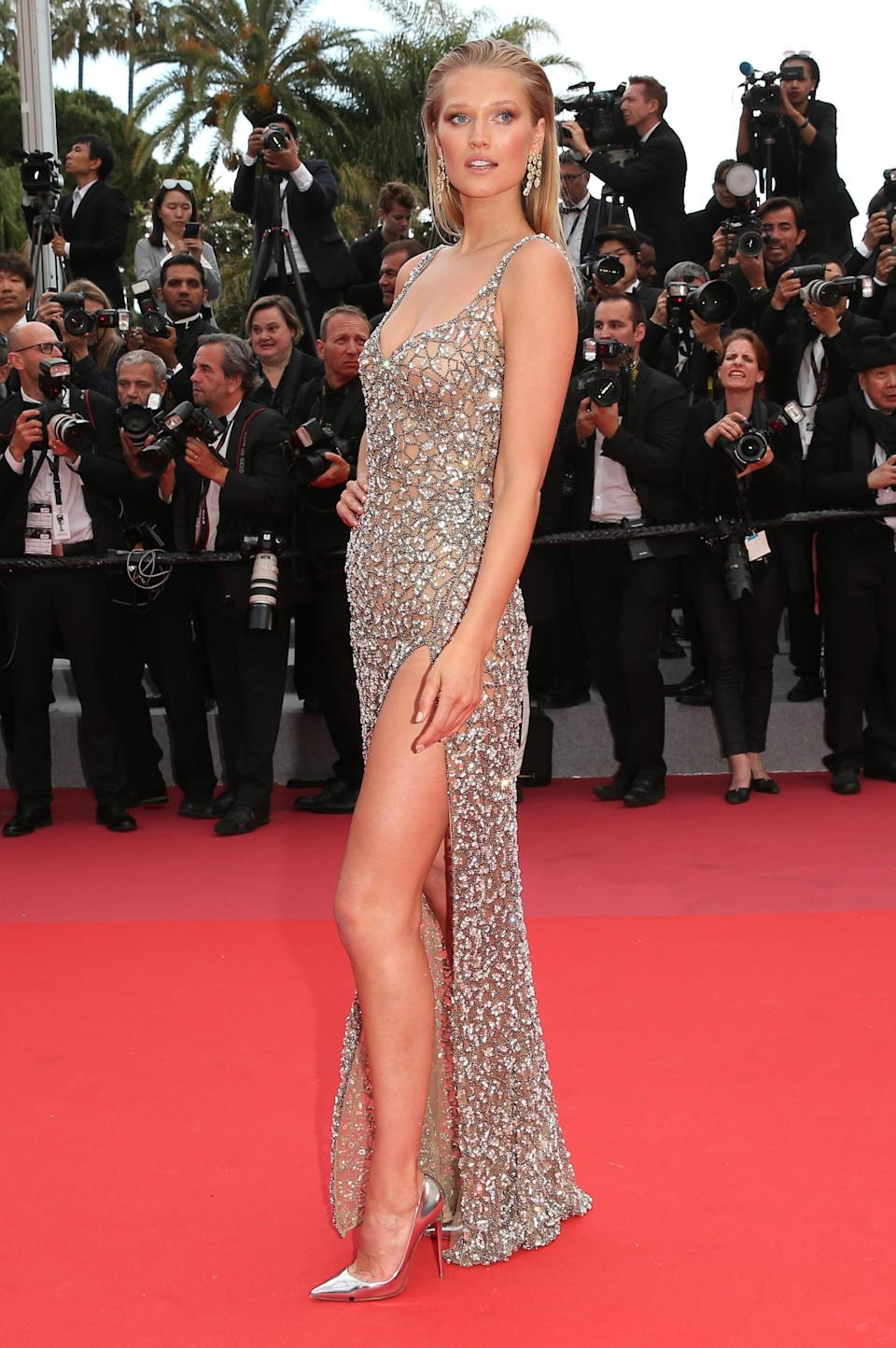 <p>The model shimmered on the red carpet in a Roberto Cavalli Couture gown with a thigh split.<br> [Photo: Getty] </p>