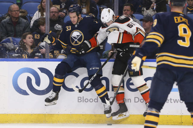 Buffalo Sabres defenseman Colin Miller (33) and Anaheim Ducks forward Troy Terry (61) collide during the second period of an NHL hockey game Sunday, Feb. 9, 2020, in Buffalo, N.Y. (AP Photo/Jeffrey T. Barnes)