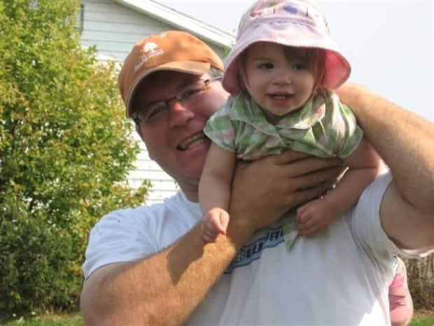 Taylor is pictured here with his daughter, who was 13 years old when her father died.