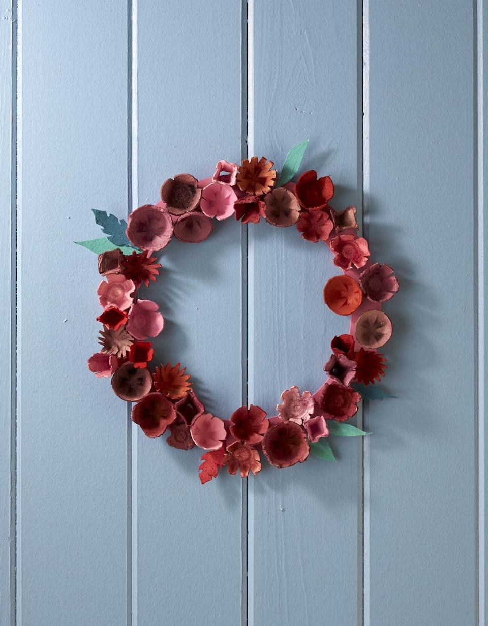 """<p>Made from the common paper egg carton this wreath will look spectacular displayed on a covered door or over the mantel.</p><p><strong>To make:</strong> Cut individual egg cups from paper egg cartons. Notch and cut decorative edges with scissors. Dye or paint cups desired colors. Attach cups and craft paper leaves to a painted craft ring with hot-glue. </p><p><a class=""""link rapid-noclick-resp"""" href=""""https://www.amazon.com/Bright-Creations-Wedding-Floral-Natural/dp/B07Z8KDMBF/ref=sr_1_8?tag=syn-yahoo-20&ascsubtag=%5Bartid%7C10050.g.1111%5Bsrc%7Cyahoo-us"""" rel=""""nofollow noopener"""" target=""""_blank"""" data-ylk=""""slk:SHOP CRAFT RING"""">SHOP CRAFT RING</a></p>"""