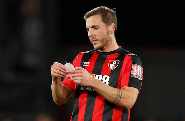 "Soccer Football - Premier League - AFC Bournemouth vs Manchester United - Vitality Stadium, Bournemouth, Britain - April 18, 2018 Bournemouth's Dan Gosling reads a note after coming on as a substitute Action Images via Reuters/John Sibley EDITORIAL USE ONLY. No use with unauthorized audio, video, data, fixture lists, club/league logos or ""live"" services. Online in-match use limited to 75 images, no video emulation. No use in betting, games or single club/league/player publications. Please contact your account representative for further details."