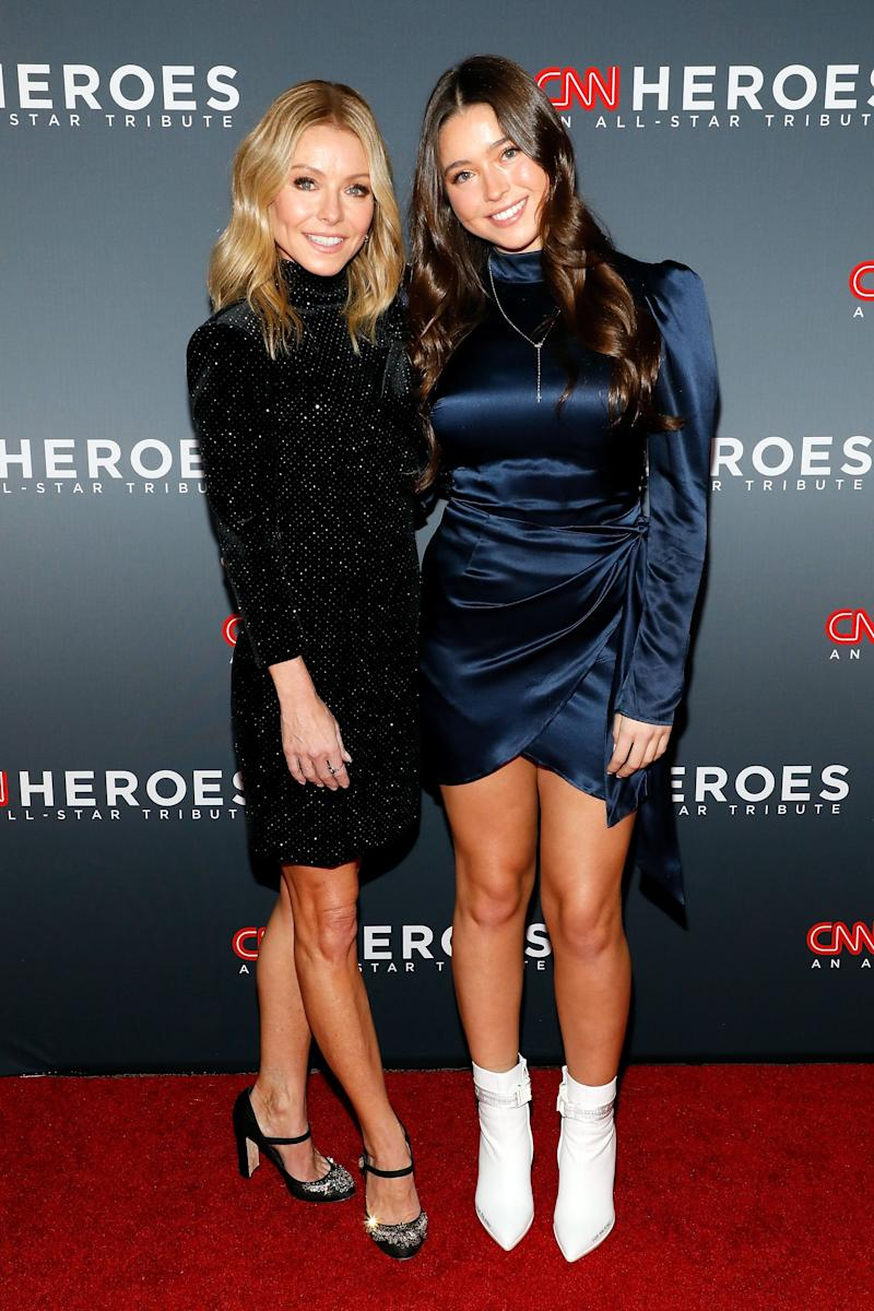 Kelly Ripa looks dazzling on a red carpet show with a friend