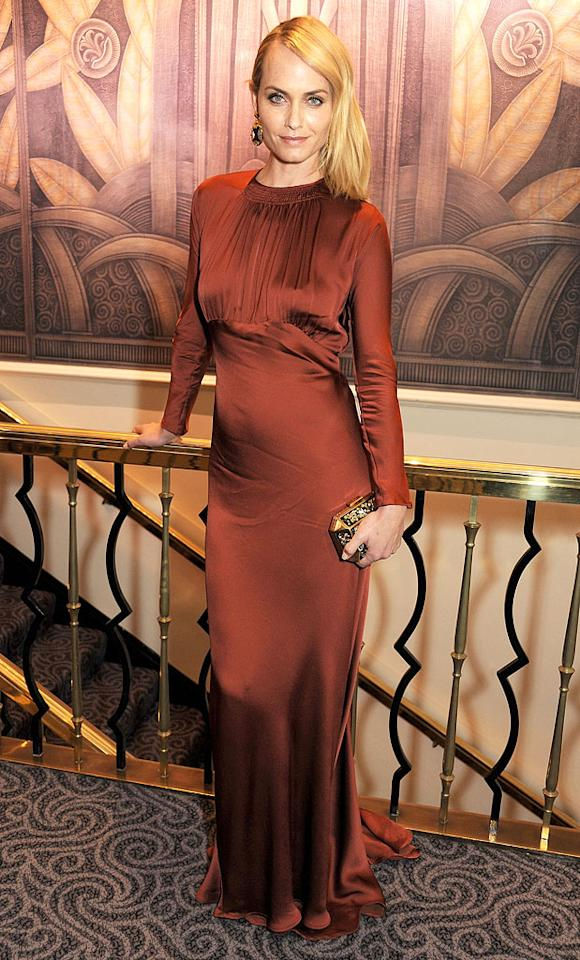 LONDON, ENGLAND - NOVEMBER 27:  (EMBARGOED FOR PUBLICATION IN UK TABLOID NEWSPAPERS UNTIL 48 HOURS AFTER CREATE DATE AND TIME. MANDATORY CREDIT PHOTO BY DAVE M. BENETT/GETTY IMAGES REQUIRED)  Amber Valletta poses at the British Fashion Awards 2012 at The Savoy Theatre on November 27, 2012 in London, England.  (Photo by Dave M. Benett/Getty Images)