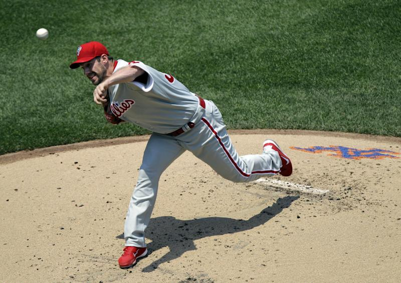 Philadelphia Phillies starting pitcher Cliff Lee delivers against the New York Mets in the first inning during their baseball game at Citi Field in New York, Wednesday, July 4, 2012. (AP Photo/Kathy Willens)