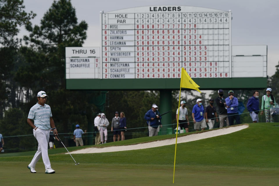 Hideki Matsuyama, of Japan, walks the the 17th green during the third round of the Masters golf tournament on Saturday, April 10, 2021, in Augusta, Ga. (AP Photo/David J. Phillip)