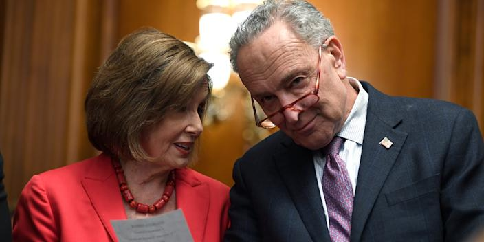 House Speaker Nancy Pelosi of Calif., left, and Senate Minority Leader Sen. Chuck Schumer of N.Y., right, talk as they wait to speak at an event on Capitol Hill in Washington, Tuesday, Nov. 12, 2019, regarding the earlier oral arguments before the Supreme Court in the case of President Trump's decision to end the Obama-era, Deferred Action for Childhood Arrivals (DACA), program. (AP Photo/Susan Walsh)
