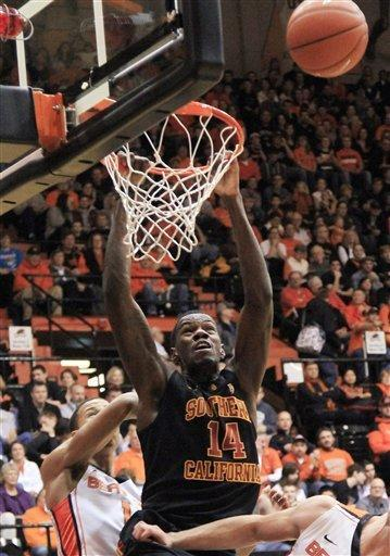 Southern California forward Dewayne Dedmon's dunk attempt bounces off the rim as Oregon State guard Jared Cunningham, left, watches during the first half of an NCAA college basketball game in Corvallis, Ore., Saturday, Jan. 21, 2012. (AP Photo/Don Ryan)