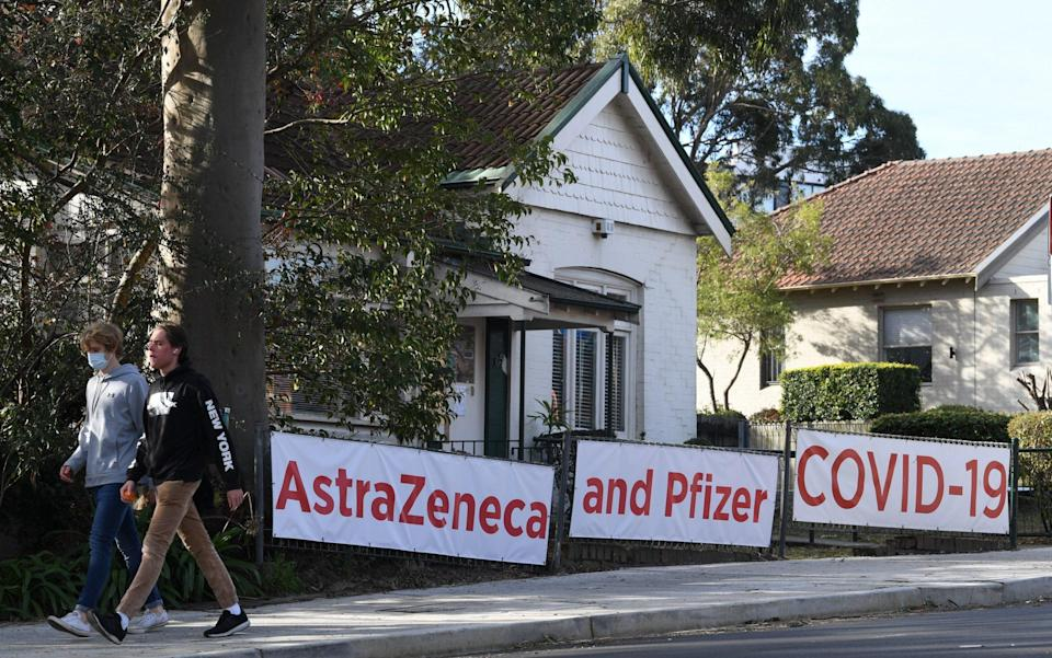 Signs advertising the coronavirus vaccine in Lane Cove, a suburb of Sydney - James D Morgan/Getty Images