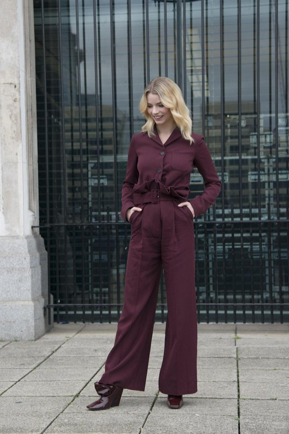 <p>Anya gave the monochromatic look a go in this maroon Mulberry set, finishing her outfit with square-toed leather boots.</p>