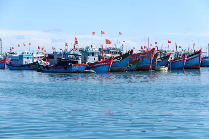 Fishing boats are docked in the harbor at Ly Son, Vietnam.