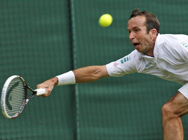 Radek Stepanek of the Czech Republic plays a return to Novak Djokovic of Serbia during their men's singles match at the All England Lawn Tennis Championships in Wimbledon, London, Wednesday, June 25, 2014. (AP Photo/Ben Curtis)