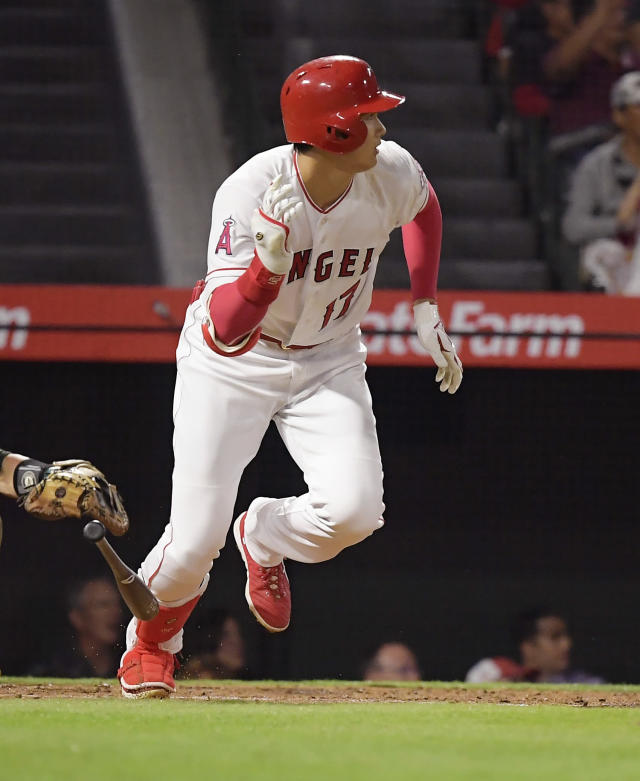Los Angeles Angels' Shohei Ohtani, of Japan, hits a single during the second inning of a baseball game against the Oakland Athletics, Friday, Sept. 28, 2018, in Anaheim, Calif. (AP Photo/Mark J. Terrill)