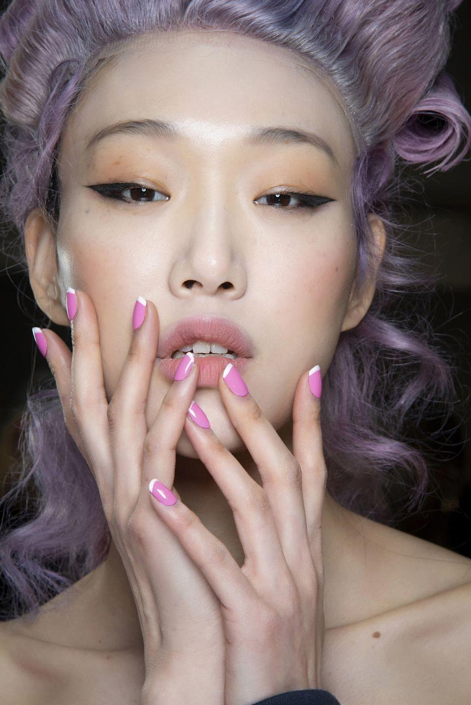 <p>At Moschino, the French manicures were done in fun and bubbly shades of candy pastels.</p>