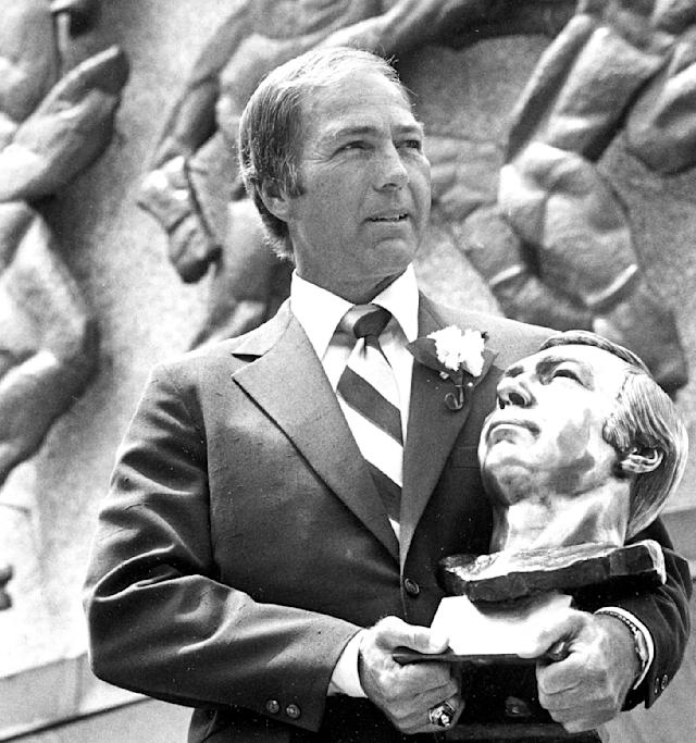 FILE - In this July 30, 1977, file photo, Bart Starr poses with his bust after his induction into the Pro Football Hall of Fame in Canton, Ohio. Starr, the Green Bay Packers quarterback and catalyst of Vince Lombardi's powerhouse teams of the 1960s, has died. He was 85. The Packers announced Sunday, May 26, 2019, that Starr had died, citing his family. He had been in failing health since suffering a serious stroke in 2014. (AP Photo)