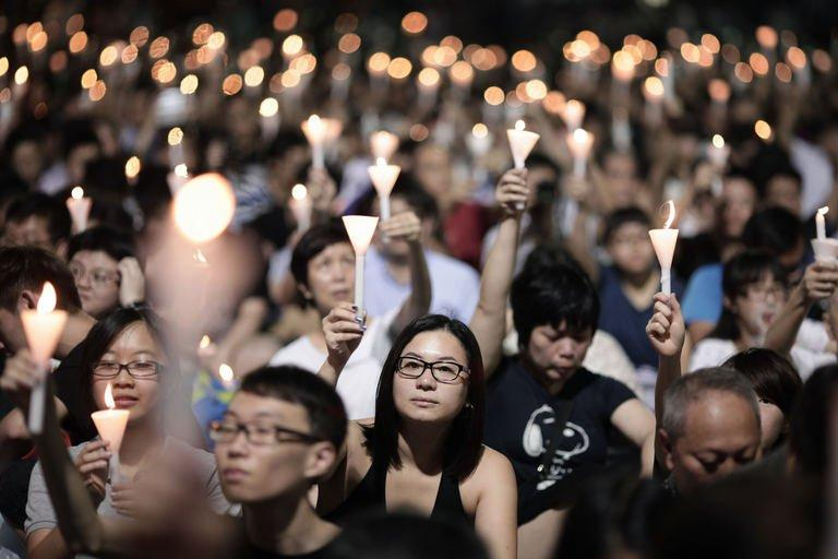 Acandlelight vigil held to mark the 24th anniversary of the 1989 crackdown at Tiananmen Square, June 4, 2013