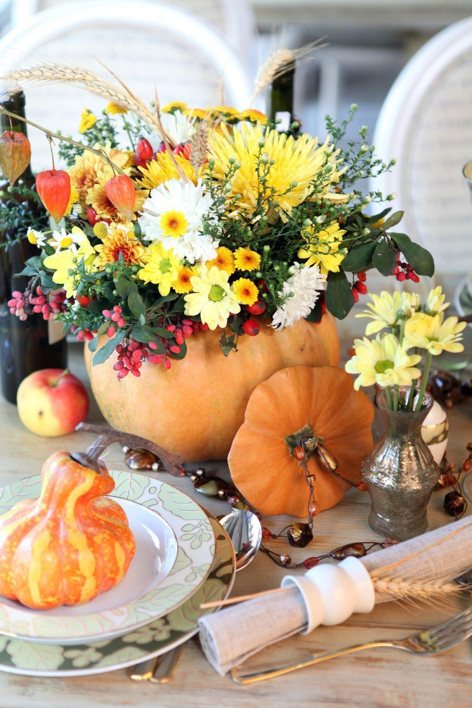 """<p>Gather a sweet grouping of wildflowers into a hollowed out pumpkin for an easy-but-show-stopping centerpiece. Place smaller gourds on guests' plates and accent the rest of the table with smaller arrangements housed in mercury glass bud vases. </p><p><a class=""""link rapid-noclick-resp"""" href=""""https://www.amazon.com/Serene-Spaces-Living-Mercury-Crackle/dp/B0182JN73C/ref=sr_1_6?dchild=1&keywords=mercury+glass+bud+vase&qid=1629996419&sr=8-6&tag=syn-yahoo-20&ascsubtag=%5Bartid%7C10050.g.2130%5Bsrc%7Cyahoo-us"""" rel=""""nofollow noopener"""" target=""""_blank"""" data-ylk=""""slk:SHOP VASES"""">SHOP VASES</a></p>"""