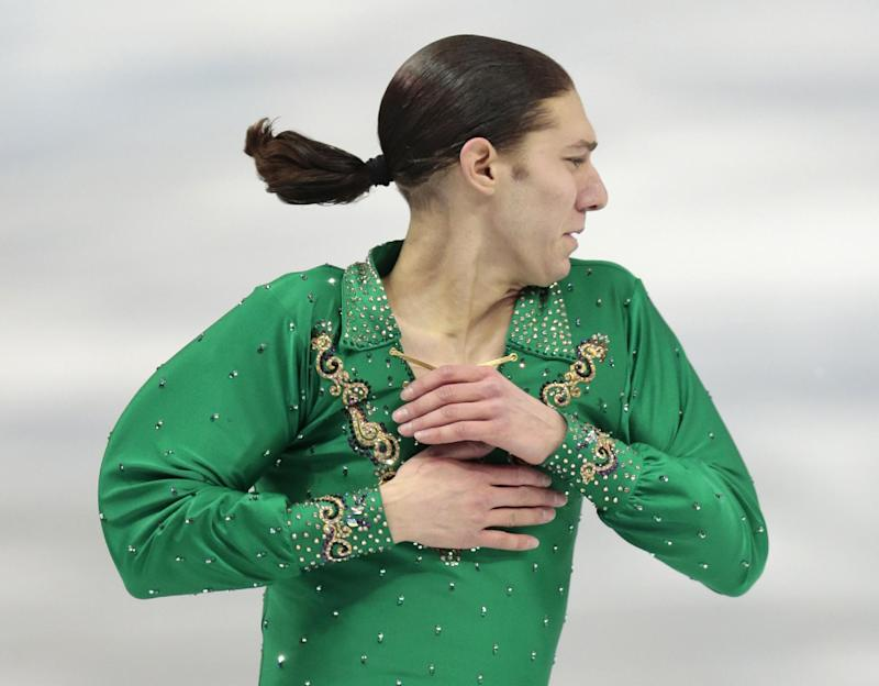 Jason Brown of the United States competes in the men's team free skate figure skating competition at the Iceberg Skating Palace during the 2014 Winter Olympics, Sunday, Feb. 9, 2014, in Sochi, Russia