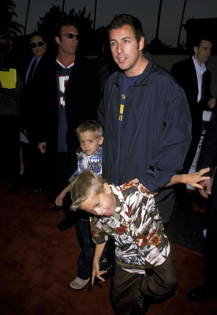 Adam Sandler, Cole Sprouse and Dylan Sprouse at the Avco Cinema in Westwood, California, in 1999. (Photo: Jim Smeal via Getty Images)