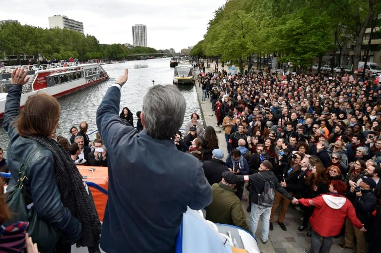 "Melenchon addresses an enthusiastic crowd on April 17, 2017, thanking them for their revolutionary spirit by saying: ""Here you are on an Easter Monday listening to a guy on a boat. There's something in the air!"""