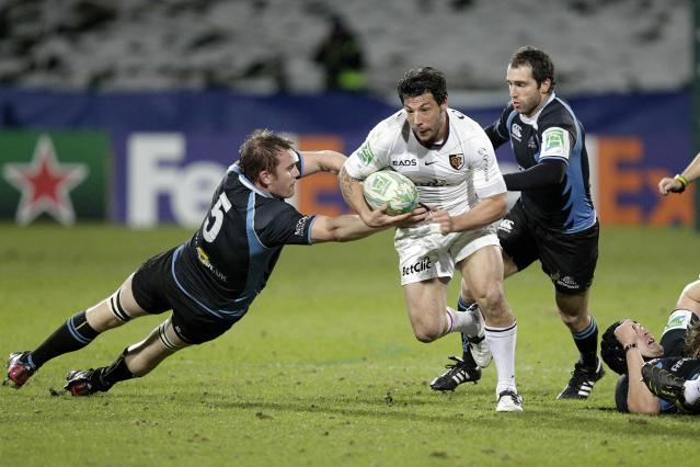 Glasgow Warriors' Alastair Kellock (L) tries to tackle Toulouse's Byron Kelleher (2nd L) during a Heineken Cup, pool six, rugby union match at Firhill Stadium in Glasgow on December 10, 2010. AFP PHOTO/GRAHAM STUART (Photo credit should read GRAHAM STUART/AFP/Getty Images)